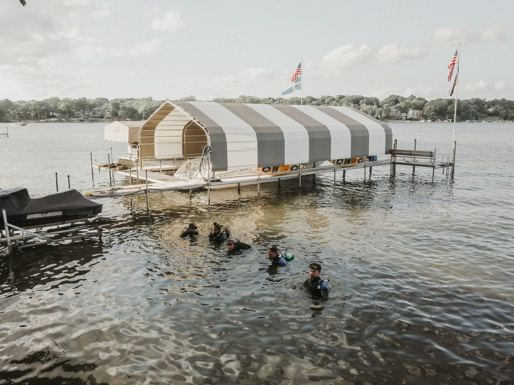 Vision of a dock and scuba divers on Lake Minnetonka.